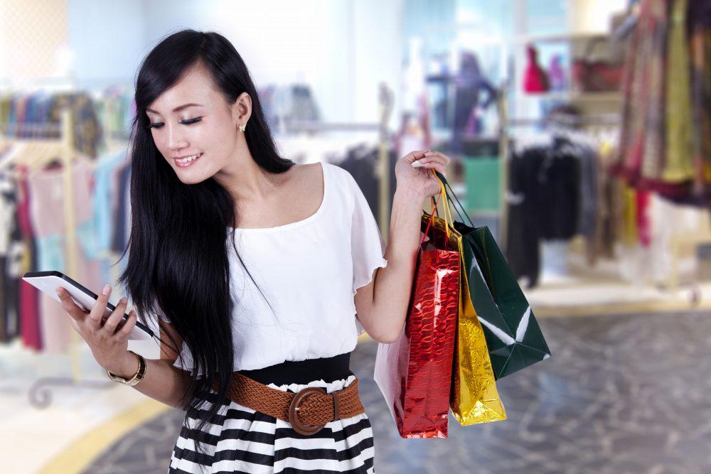 Beautiful woman at shopping center