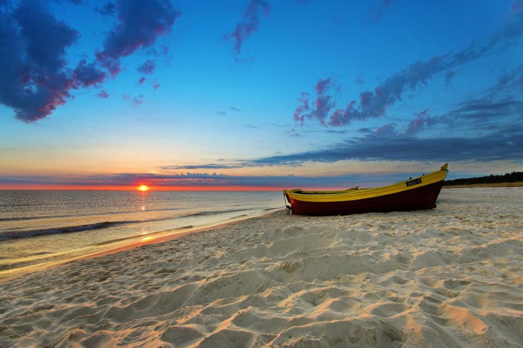 Poland, , Gdansk - near, Beach scene with boat at sunset