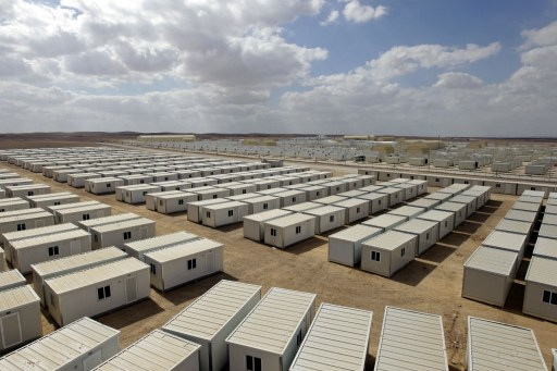 A general view of the new Mrigeb al-Fuhud refugee camp, 20 kilometres east of the city of the Jordanian city of Zarqa, is seen as Jordan opened a second camp for Syrian refugees after the United Nations said the number seeking shelter in the kingdom is expected to triple by the end of the year on April 10, 2013. The seven-million-dinar ($9.8-million) camp, which was paid for by the United Arab Emirates, has 750 caravans, a hospital and a school and can take up to 5,500 people. AFP PHOTO / KHALIL MAZRAAWI