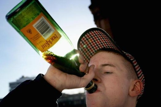 "GLASGOW, SCOTLAND - JANUARY 27: A youth drinks Buckfast tonic wine on the banks of the River Clyde. January 27, 2005 in Glasgow, Scotland. The Scottish Executive has announced a major campaign designed to call time on the binge drinking culture which creates bad health and anti social behaviour. The UK government has announced that the drinks industry will pay towards policing town centres when 24 hour licensing is introduced in the UK later this year. It is estimated that drink related problems cost the people of Scotland over GBP1bn a year. Glasgow City Council has already banned ""happy hours"" where cut price drinks can be bought at specific times. (Photo by Christopher Furlong/Getty Images)"