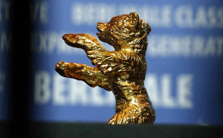 The Golden Bear for Best Film 'Taxi' of absent Iranian director Jafar Panahi is displayed during a press conference after the award ceremony at the 2015 Berlinale Film Festival in Berlin, Germany, Saturday, Feb. 14, 2015. (AP Photo/Axel Schmidt)